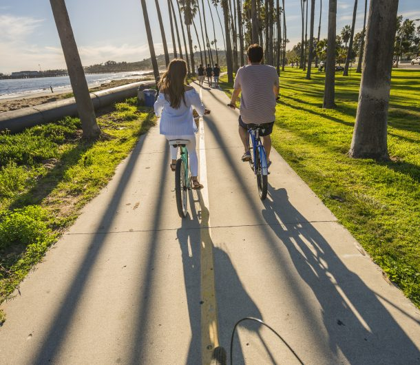 A Couple riding beach cruisers along the SB waterfront